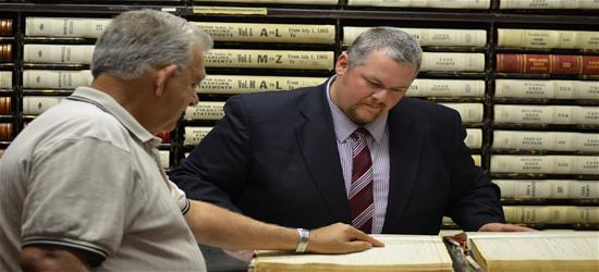 Mike Medsker helping locate a historic document